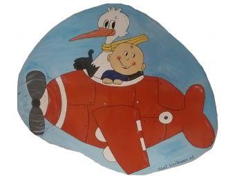 Ooievaar rood vliegtuigje