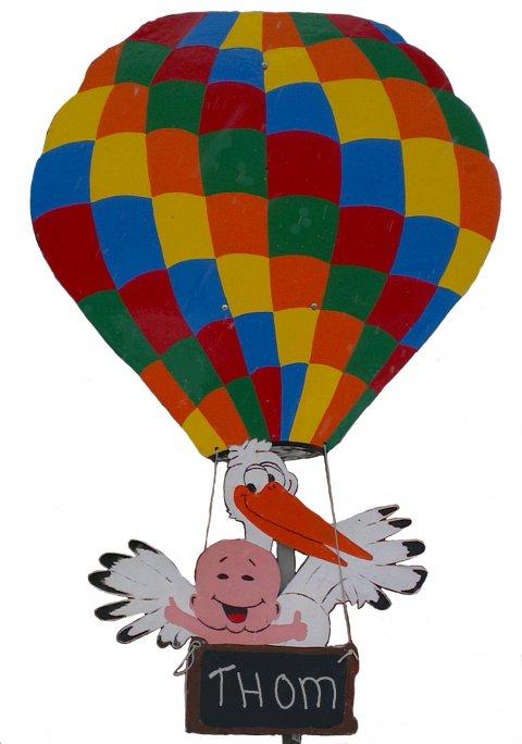 Ooievaar in gekleurde ballon foto